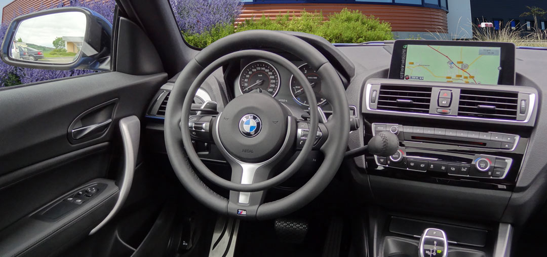 BMW 1-serie with hand controls for disabled drivers by Kempf