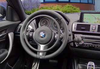 BMW 1-serie with Darios accelerator ring and main hand brake as hand controls