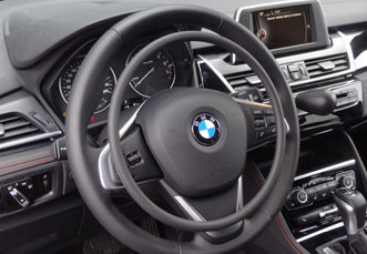 BMW 2-serie with digital hand controls by Kempf